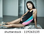Young pregnant asian woman indoors. - stock photo