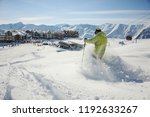 skier dressed in bright yellow... | Shutterstock . vector #1192633267