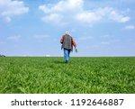 senior farmer in filed...   Shutterstock . vector #1192646887