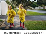 two identical twin sisters... | Shutterstock . vector #1192650967