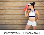 young woman jogger in fitness...   Shutterstock . vector #1192675621