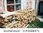 firewood in woodpile under the... | Shutterstock . vector #1192688371