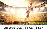 intense soccer moment in front... | Shutterstock . vector #1192748827