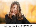 young girl against an autumn... | Shutterstock . vector #119275315