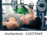 young man lifting the barbell... | Shutterstock . vector #119275369
