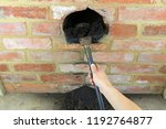 sweeping chimney with a brush... | Shutterstock . vector #1192764877