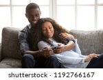 black cheerful married couple... | Shutterstock . vector #1192766167
