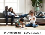 happy black family spend free... | Shutterstock . vector #1192766314