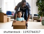 black family in living room... | Shutterstock . vector #1192766317