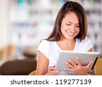 woman reading at the library on ... | Shutterstock . vector #119277139