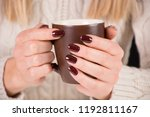 girl with cup of coffee and... | Shutterstock . vector #1192811167