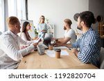 young team of coworkers making... | Shutterstock . vector #1192820704