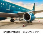 Airplane and engine in Noi Bai airport, Hanoi, Vietnam in a summer day - stock photo