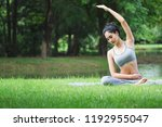 fitness asian woman doing yoga... | Shutterstock . vector #1192955047