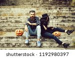 young halloween couple of... | Shutterstock . vector #1192980397