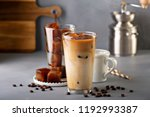 iced coffee in tall glasses... | Shutterstock . vector #1192993387