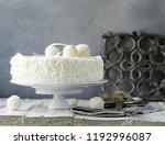 white coconut cake with creamy... | Shutterstock . vector #1192996087