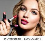 beautiful woman holds ...   Shutterstock . vector #1193001847