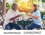 two senior asian or friends is... | Shutterstock . vector #1193025907