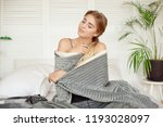 young happy woman sitting on... | Shutterstock . vector #1193028097