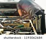 engineer at garage workshop... | Shutterstock . vector #1193062684