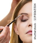 young woman getting her eyebrow ...   Shutterstock . vector #1193065504