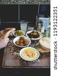 having an israeli lunch at cafe ... | Shutterstock . vector #1193122351