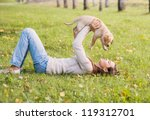 Girl With Her Dog Resting...