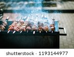 shish kebab on skewers is fried ...   Shutterstock . vector #1193144977