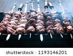 shish kebab on skewers is fried ...   Shutterstock . vector #1193146201
