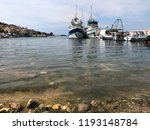 fishing boats in the harbor of... | Shutterstock . vector #1193148784