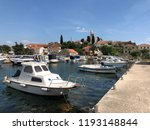 boats in the harbor of the town ... | Shutterstock . vector #1193148844