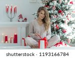 woman at christmas | Shutterstock . vector #1193166784