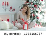 woman at christmas | Shutterstock . vector #1193166787