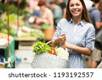 young woman on the market | Shutterstock . vector #1193192557