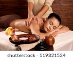 masseur doing massage on woman... | Shutterstock . vector #119321524