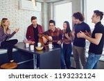 friends playing the guitar ... | Shutterstock . vector #1193232124