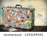 old suitcase with stikkers on... | Shutterstock . vector #1193259541