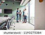 casually dressed businessmen... | Shutterstock . vector #1193275384