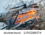 ax in a burning pyre  charred... | Shutterstock . vector #1193288374