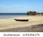 lonely boat anchored dry on a... | Shutterstock . vector #1193296174