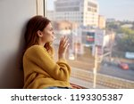 woman touches the glass with... | Shutterstock . vector #1193305387