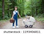 little newborn baby boy and his ... | Shutterstock . vector #1193406811