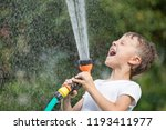 happy little boy pouring water... | Shutterstock . vector #1193411977