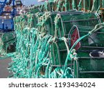 Pile Of Green Fish Traps On The ...