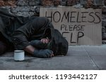 Homeless Man Lies On The Street ...