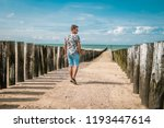 beach poles on the beach of... | Shutterstock . vector #1193447614