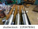 the drills lie on a rack near... | Shutterstock . vector #1193478361