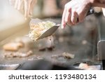 hand of man take cooking of... | Shutterstock . vector #1193480134