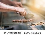 hand of man take cooking of... | Shutterstock . vector #1193481691